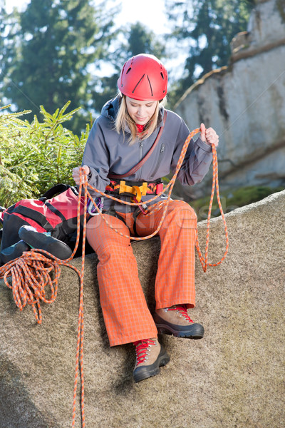 Active woman rock climbing holding rope Stock photo © CandyboxPhoto