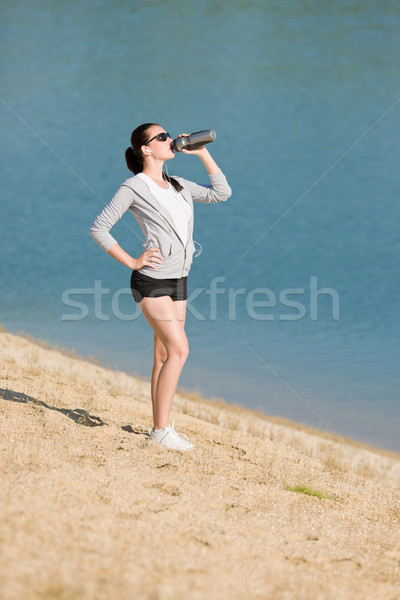 Summer sport fit woman drink water bottle Stock photo © CandyboxPhoto