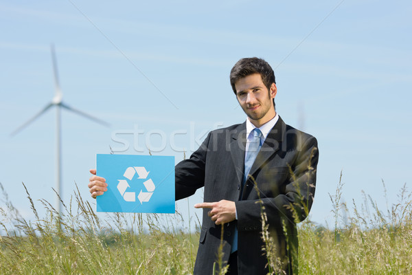 Stock photo: Green energy young businessman hold recycling sign