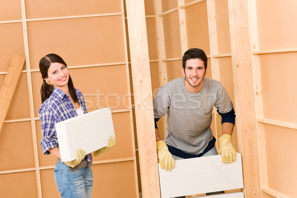 Home improvement young couple building brick wall Stock photo © CandyboxPhoto