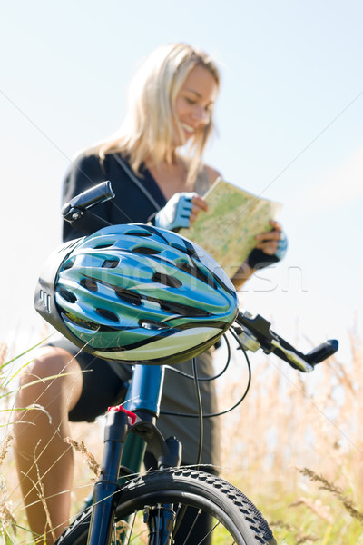 Mountain biking young woman search in map Stock photo © CandyboxPhoto