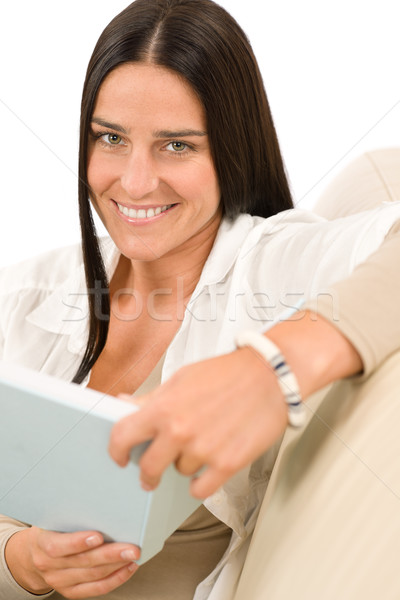 Happy woman with book sitting on sofa Stock photo © CandyboxPhoto