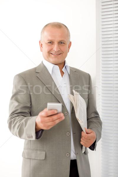 Businessman mature smiling hold phone portrait Stock photo © CandyboxPhoto