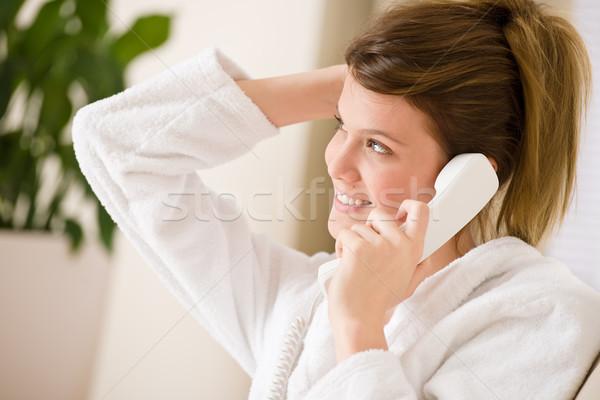счастливым женщину белый халат телефон домой Сток-фото © CandyboxPhoto