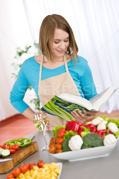 Cooking - Woman reading cookbook in kitchen Stock photo © CandyboxPhoto