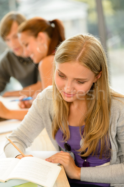 High-school student taking notes in library study Stock photo © CandyboxPhoto