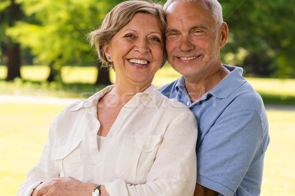 Senior citizen couple laughing outdoors Stock photo © CandyboxPhoto