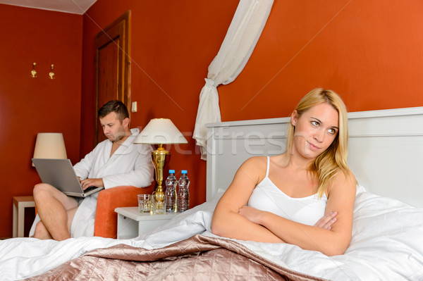 Upset girl sitting bed after fight boyfriend Stock photo © CandyboxPhoto