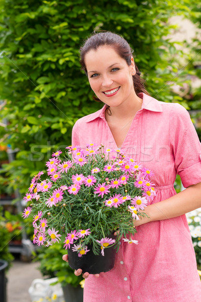 Smiling woman hold pink potted flower Stock photo © CandyboxPhoto