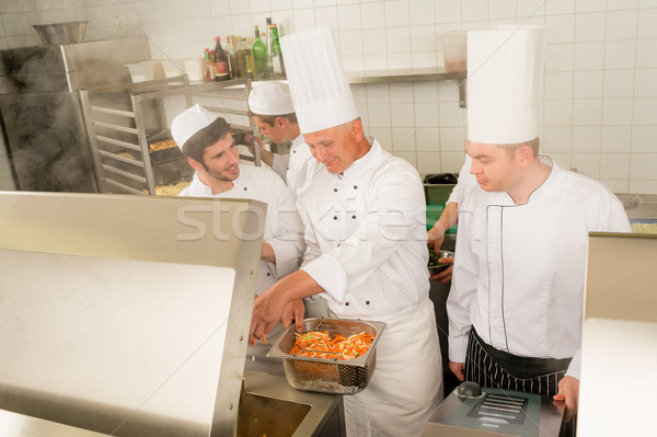 Professional chef cook prepare food in kitchen Stock photo © CandyboxPhoto