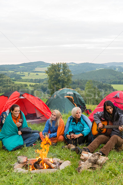 Smiling girls camping on weekend with tents Stock photo © CandyboxPhoto