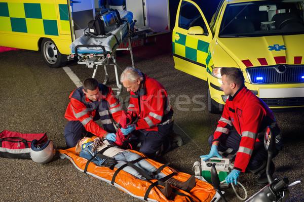 помогают мотоцикле драйвера раненый женщину Сток-фото © CandyboxPhoto