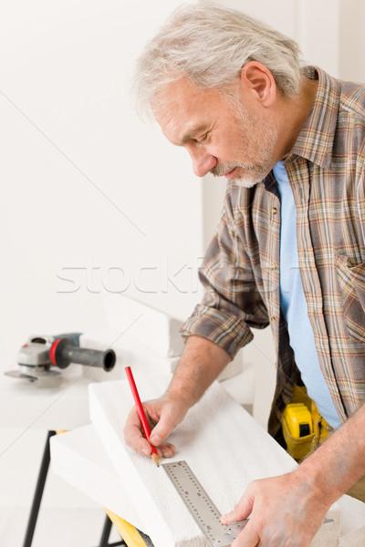 Home improvement - handyman measure porous brick Stock photo © CandyboxPhoto