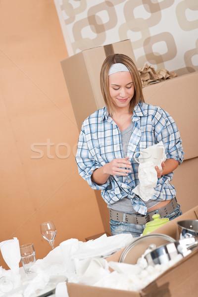 Moving house: Woman unpacking box Stock photo © CandyboxPhoto