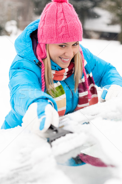 Woman brushing snow from car windscreen winter Stock photo © CandyboxPhoto