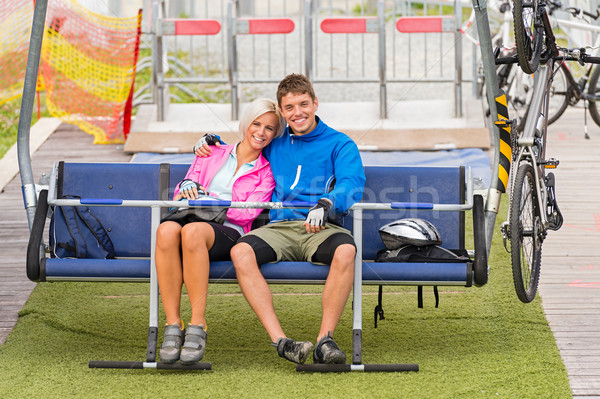 Cuddling couple sitting chair lift with bicycles Stock photo © CandyboxPhoto