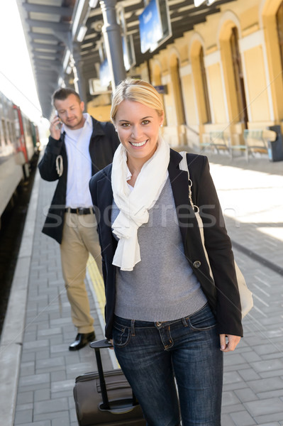 Woman in train station man on cellphone Stock photo © CandyboxPhoto
