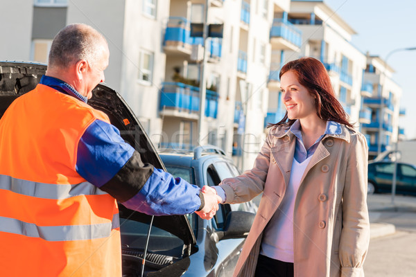 Stock photo: Woman greeting mechanic after her car breakdown