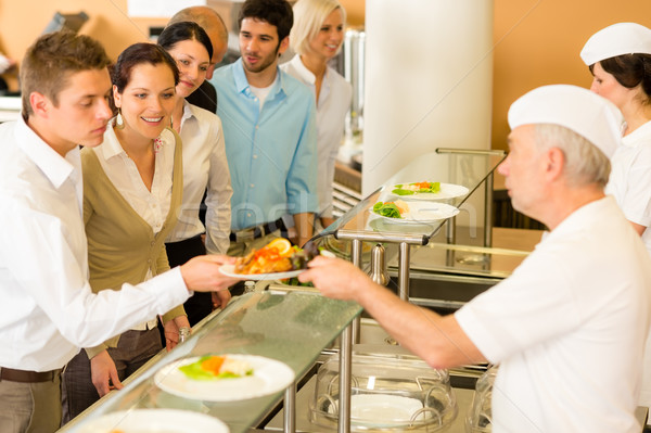 Office colleagues in canteen cook serve meals Stock photo © CandyboxPhoto