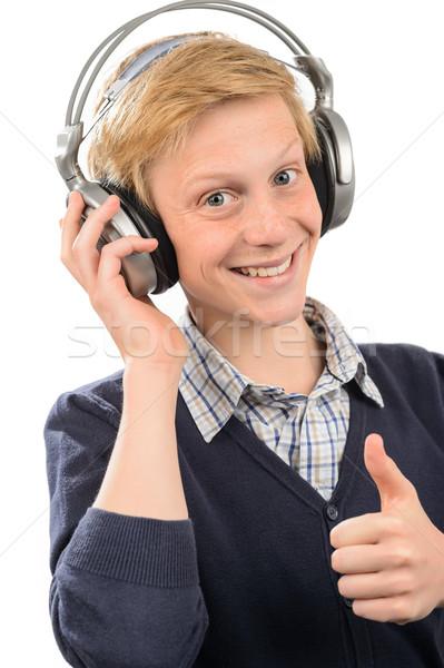 Boldog tizenéves fiú fejhallgató visel zenét hallgat izolált Stock fotó © CandyboxPhoto