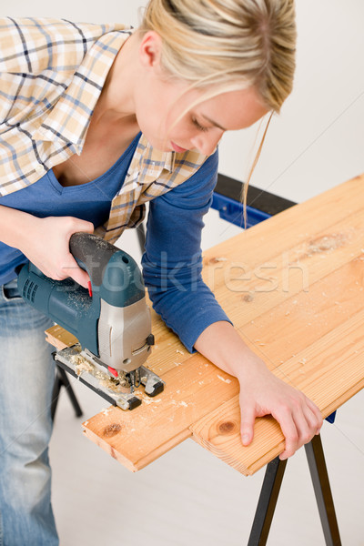 Home improvement - handywoman cutting wooden floor Stock photo © CandyboxPhoto