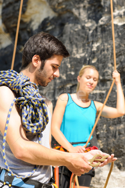 Rock climbing man showing woman rope knot Stock photo © CandyboxPhoto