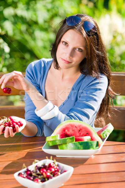 Fresh cherries melon woman garden summer terrace Stock photo © CandyboxPhoto