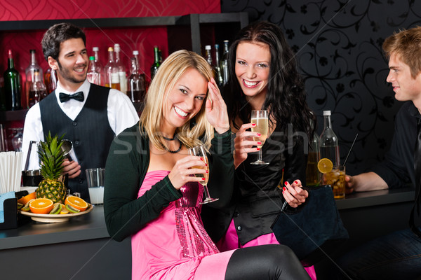 Happy girl friends with drinks enjoying party Stock photo © CandyboxPhoto