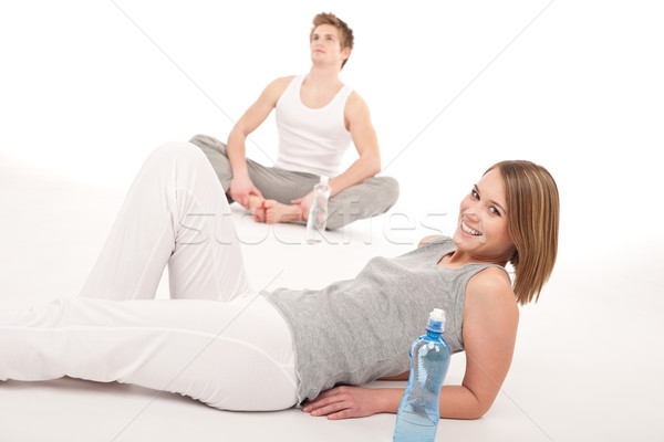 Fitness - Healthy couple stretching after training on white Stock photo © CandyboxPhoto