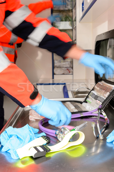 Rushing paramedics with medical equipments Stock photo © CandyboxPhoto
