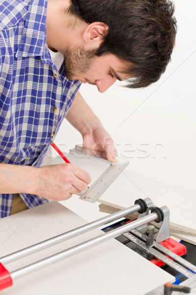 Stock photo: Home improvement - handyman cut tile