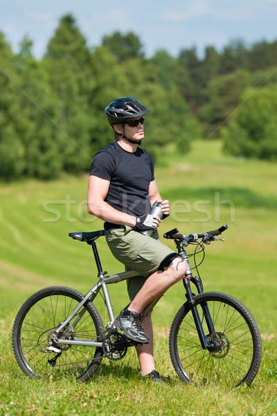 Sportive man mountain biking relax sunny meadows Stock photo © CandyboxPhoto