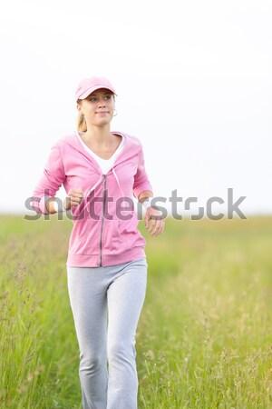 Jogging młoda kobieta uruchomiony parku dziedzinie młodych Zdjęcia stock © CandyboxPhoto