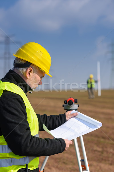 Geodesist male look land plans measure theodolite Stock photo © CandyboxPhoto