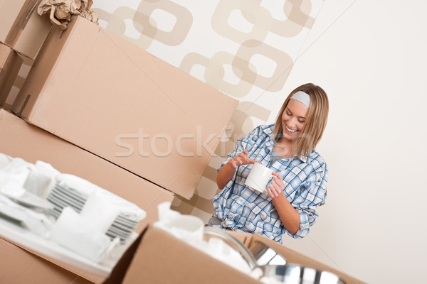 Moving house: Happy woman with box  Stock photo © CandyboxPhoto