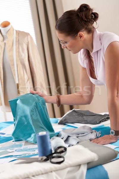 Stock photo: Female fashion designer working at studio