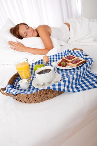 Fiatal nő házi reggeli ágy alszik kávé Stock fotó © CandyboxPhoto
