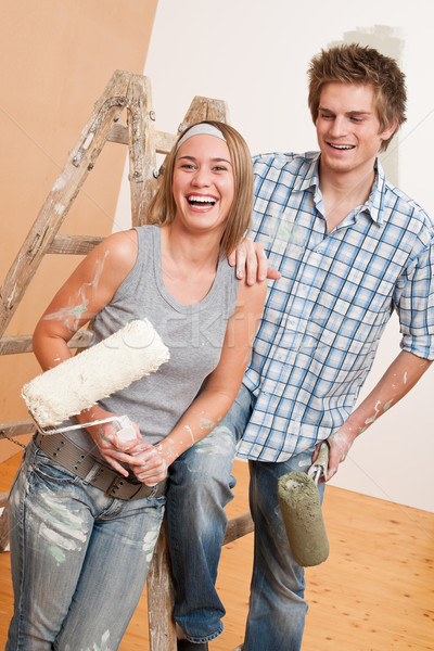 Home improvement: Young couple painting wall  Stock photo © CandyboxPhoto