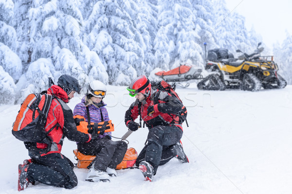 Ski patrol team rescue woman broken arm Stock photo © CandyboxPhoto