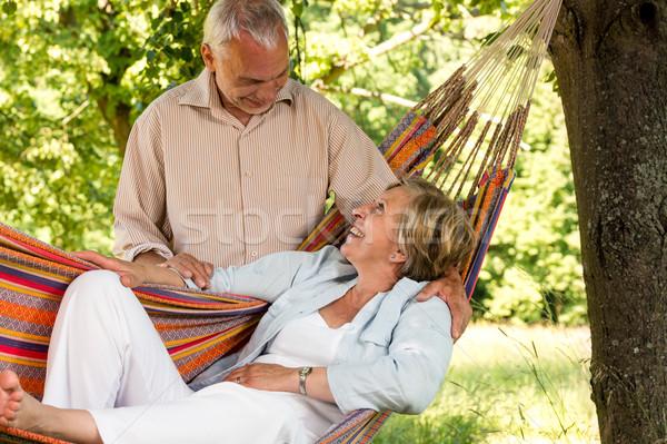 Boldog idős pár pihen függőágy kint néz Stock fotó © CandyboxPhoto
