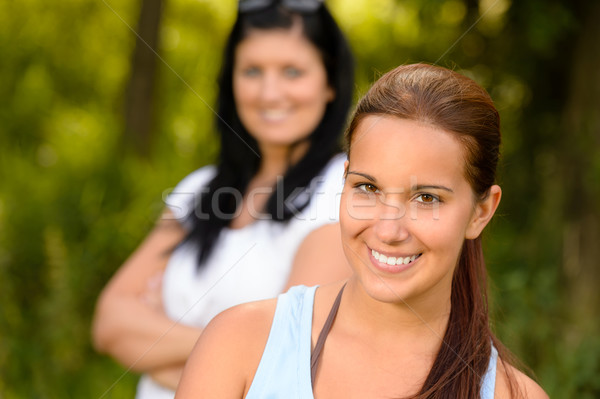Teen girl smiling with mother in background Stock photo © CandyboxPhoto