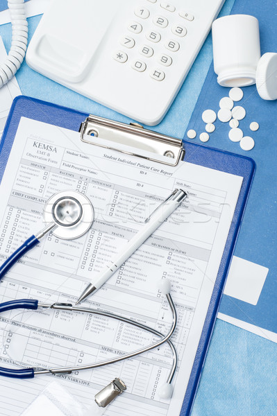 Medical patient report on doctor office desk Stock photo © CandyboxPhoto