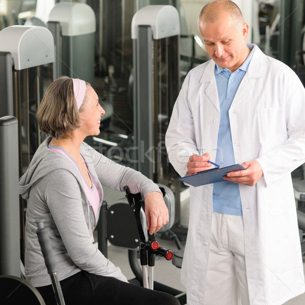 Stock photo: Physiotherapist assist active senior woman at gym