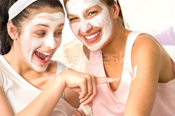 Caucasian girls wearing peeling mask having fun Stock photo © CandyboxPhoto
