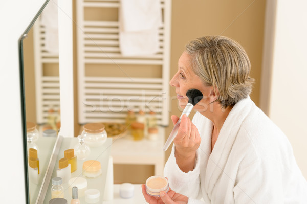 Senior woman apply make-up powder in bathroom Stock photo © CandyboxPhoto