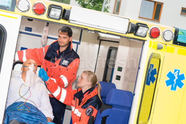 Paramedics checking IV drip patient in ambulance Stock photo © CandyboxPhoto