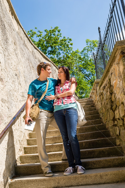 Young happy couple standing on stairs smiling Stock photo © CandyboxPhoto