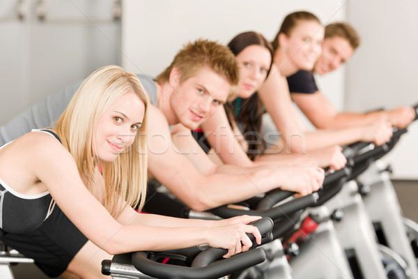Fitness group of people on gym bike  Stock photo © CandyboxPhoto