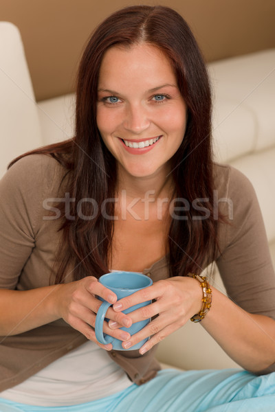 Attractive woman sitting on modern home sofa Stock photo © CandyboxPhoto