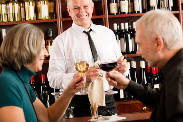 Wine bar senior couple barman pour glass Stock photo © CandyboxPhoto
